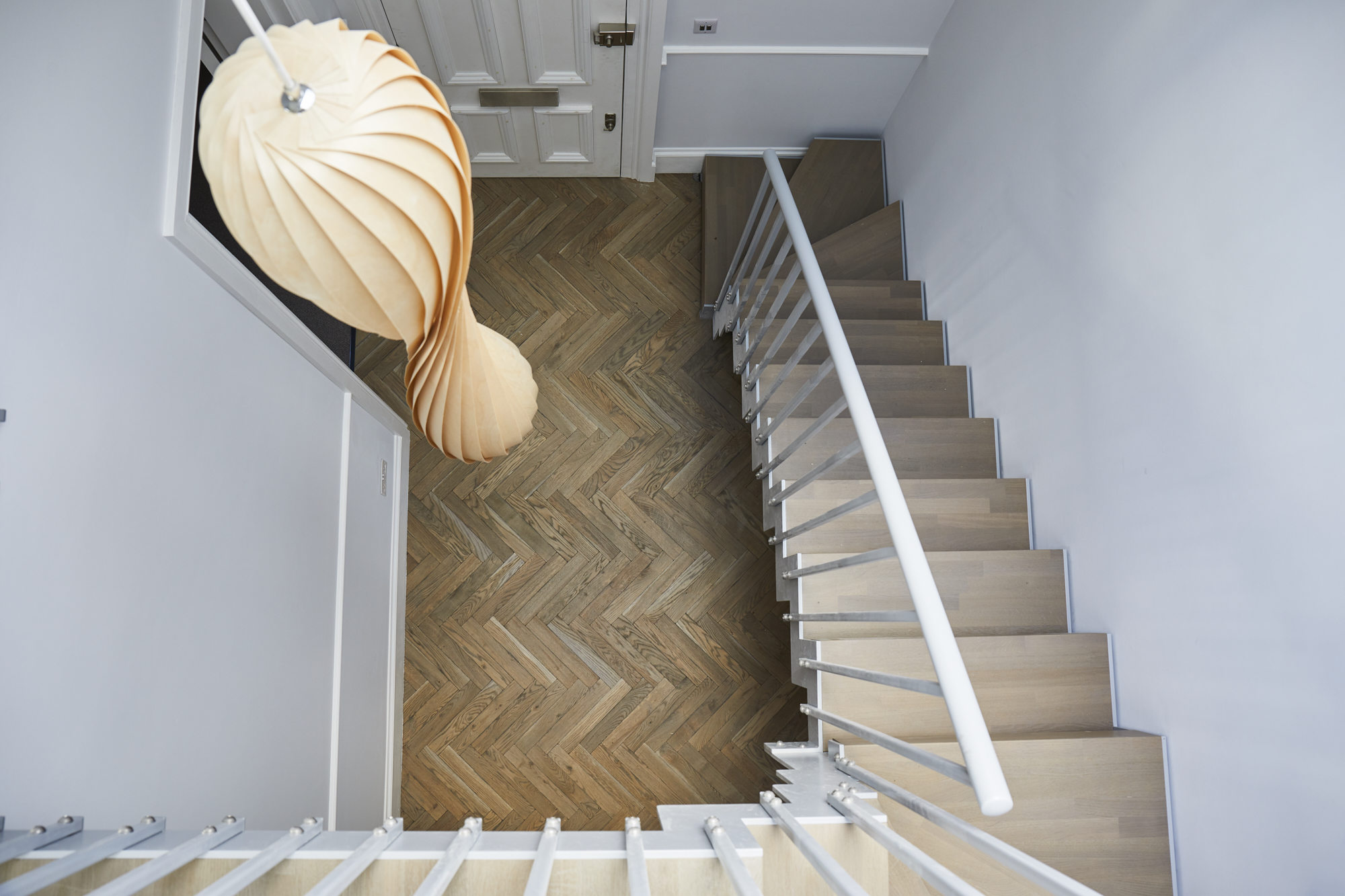 BPM33-Victorian-Penthouse-London-Chiswick-Staircase-Pendant-Herringbone-Parquet-from-Upstairs_scaled_Y