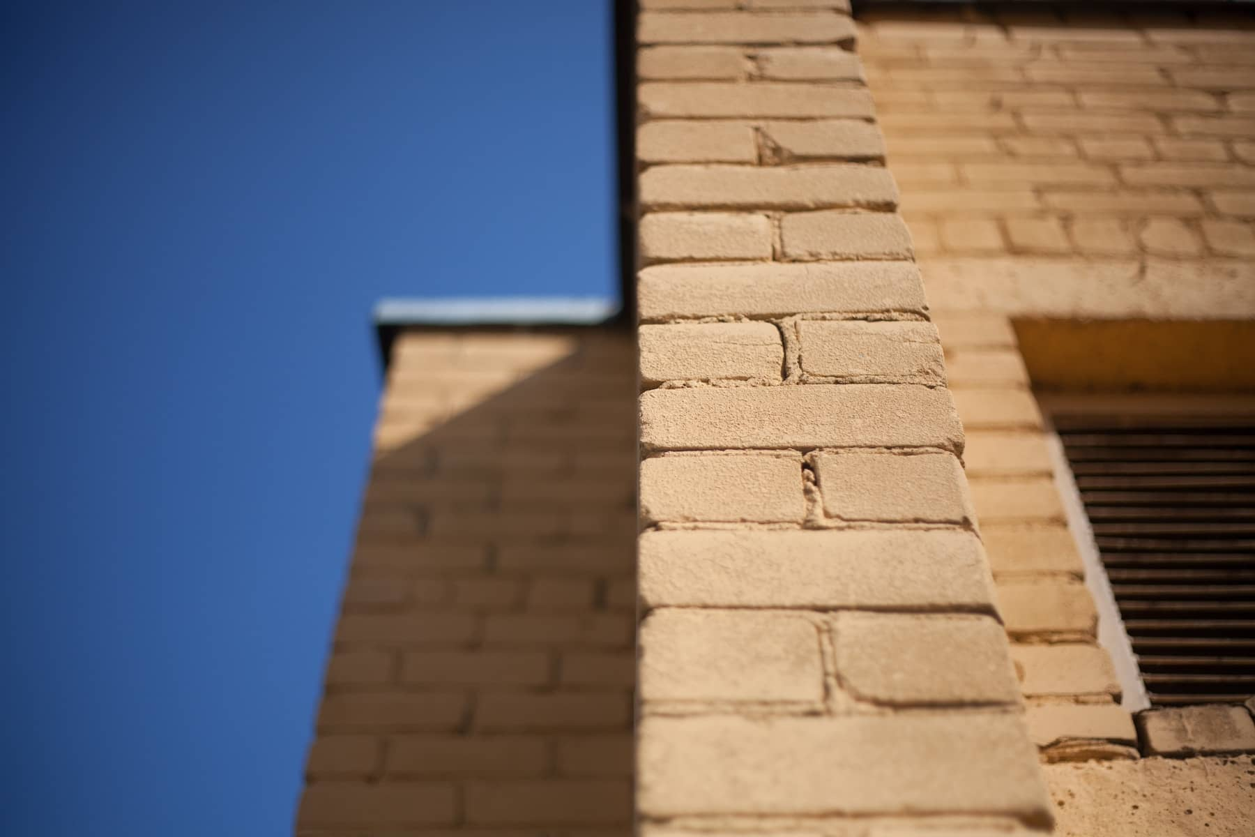 How do construction companies select building materials?