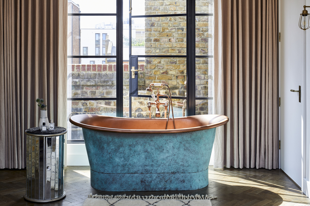 1100 prime contemporary penthouse Aldgate master bedroom copper bath tub bespoke steel windows