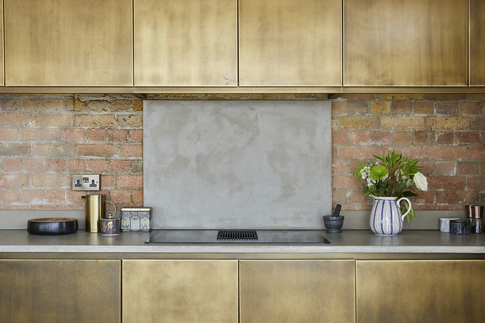 1235 prime contemporary penthouse Aldgate copper kitchen cabinets natural stone splashback
